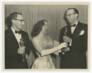 Ray Evans and Jay Livingston receiving their Academy Awards from Kathryn Grayson in for 'Mona Lisa'.
